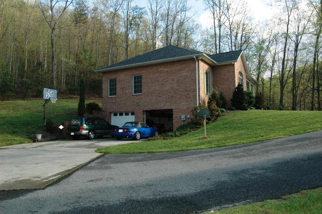 My garage is in my basement. Very common around here & Basement garage ideas? - The Garage Journal Board